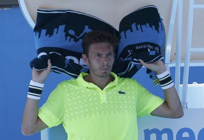 Mahut of France cools off with a towel during his men