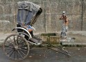 A rickshaw puller baths by the roadside on a winter morning in Kolkata