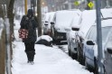 A pedestrian walks through the snow in Somerville