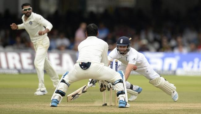 England's Anderson is run out