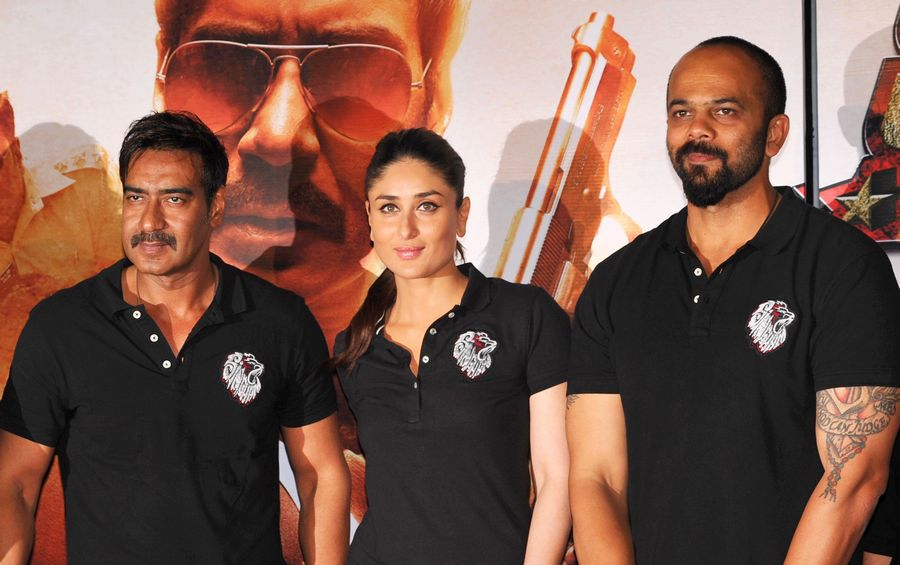 Ajay Devgn, Kareena Kapoor Khan, Rohit Shetty made an impressive trio at the trailer launch of Singham Returns. Photo: AFP
