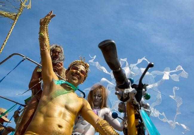 People take part in the Mermaid Parade at Coney Island in Brooklyn