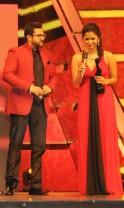 Sohini Sarkar (R) takes the 'Best Debut Female' award during 1st Vivel Filmfare Awards 2013 (East) at Science City auditorium in Kolkata