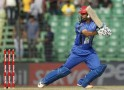 Afghanistan's Mangal plays a ball against Bangladesh during their ODI cricket match in Asia Cup 2014 in Fatullah.