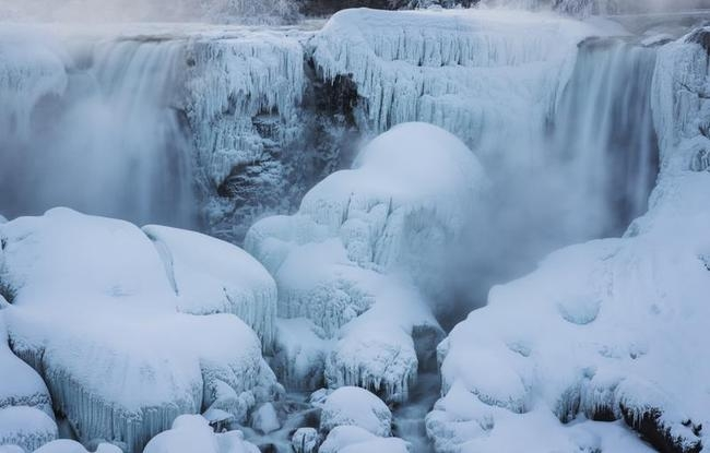 A partially frozen Niagara Falls is seen on the American side during sub freezing temperatures in Niagara Falls