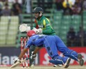 Afghanistan's Mangal jumps to avoid a run out as Bangladesh's wicketkeeper watches during their ODI cricket match for Asia Cup 2014 in Fatullah.