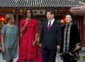 U.S. first lady Michelle Obama, her mother Marian Robinson share a light moment with Chinese President Xi and his wife Peng Liyuan after a photograph session at the Diaoyutai State guest house in Beijing