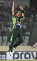 Pakistan's Afridi reacts as he bowls against Sri Lanka during their 2014 Asia Cup final match in Dhaka