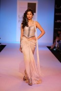 "Describing her clothes as classic with a sense of madness, Tanya Sharma's collection at Lakmé Fashion Week Summer/Resort 2014 was aptly called ""Out of the Box"". Her ""GaGa"" label has always spelt edgy, tough but slightly feminine clothes which h"