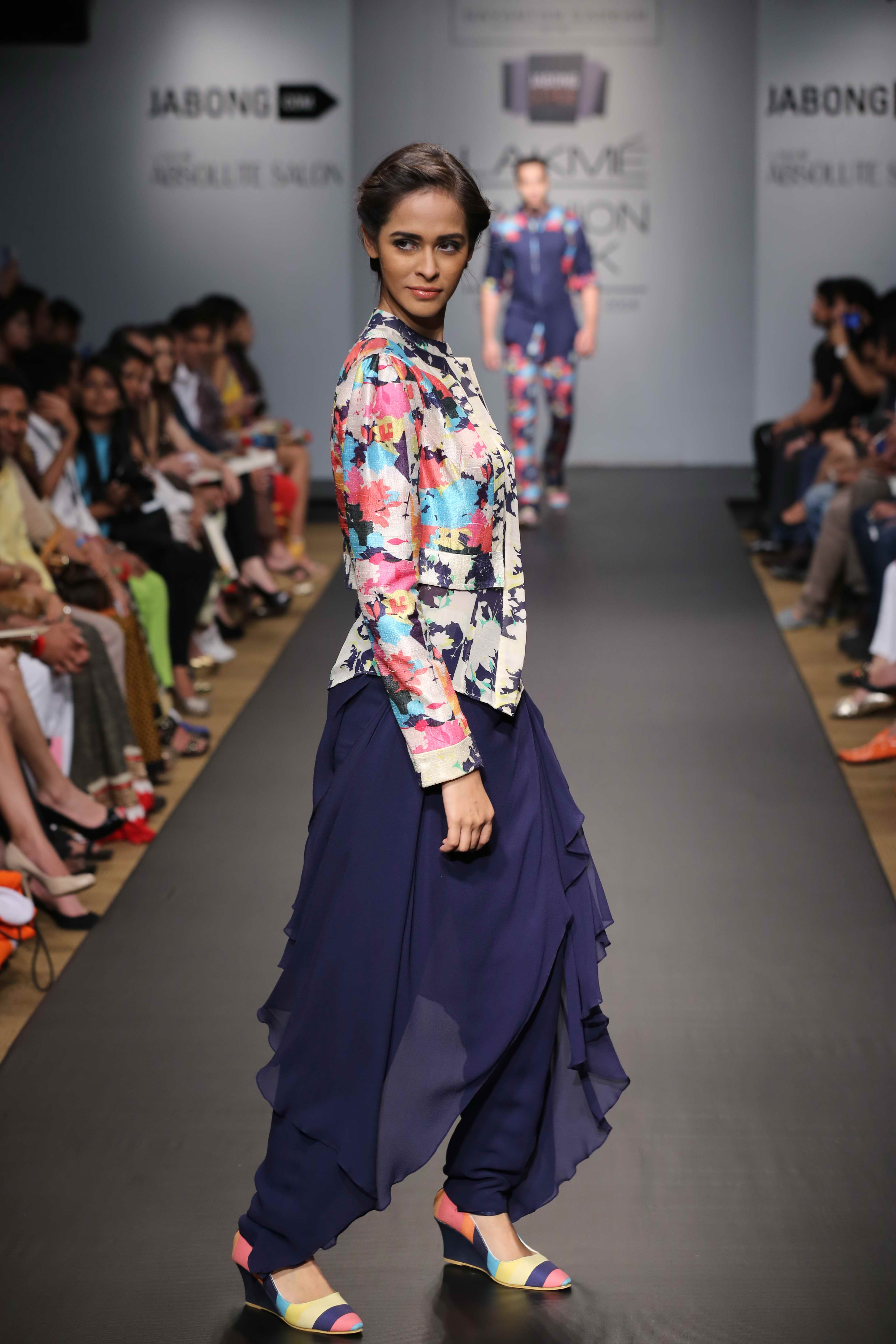 Sayantan Sarkar showcased a high-end line of evening wear christened 'A Motley Love' at Jabong Stage during Lakmé Fashion Week Summer/Resort 2014. The designer stuck to strong colours such as neon kissed pink, grey streaked purple, seductive black,