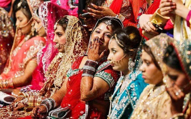 Muslim brides wait for start of mass marriage ceremony in Mumbai