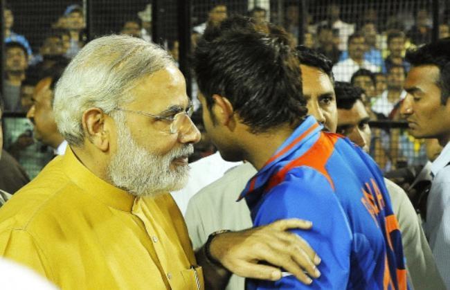 Modi Pats MS Dhoni On the back