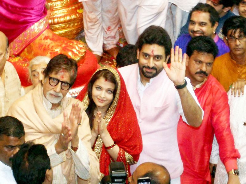 Bollywood took time to pray and pay homage to Lord Ganesh as Chaturthi celebrations kicked off in Mumbai. Amitabh Bachchan, Aishwarya Rai Bachchan and Abhishek Bachchan were snapped at one of the city's most famous Ganpati pandals, the Lalbaughcha Raja. Photo: PTI