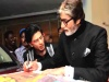 Big B Signs Autograph For Shah Rukh Khan