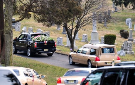 A hearse carrying Whitney Houston's body arrives