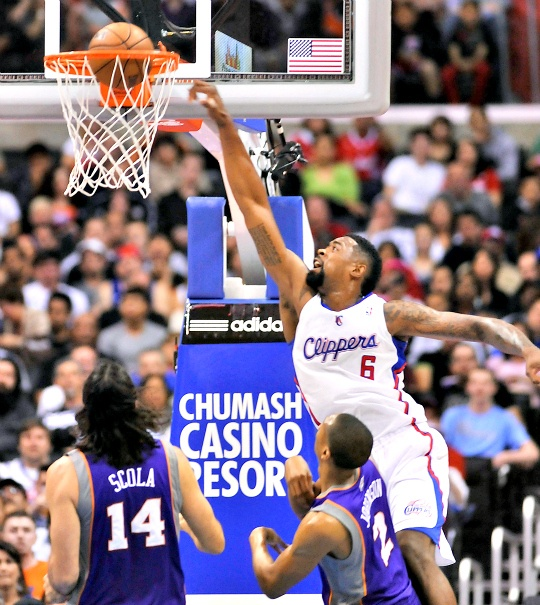 Los Angeles Clippers center DeAndre Jordan (6) throws down a dunk in front of Phoenix Suns forward Luis Scola (14), of Argentina, and forward Wesley Johnson (2)