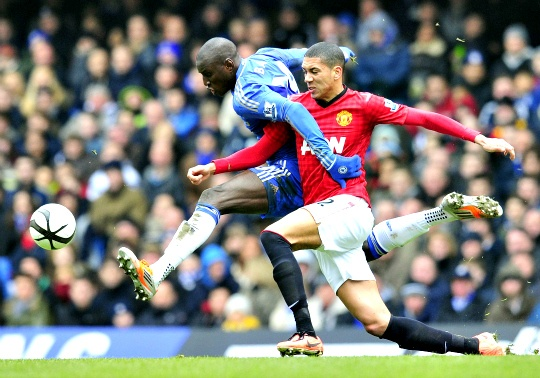 Manchester United's English defender Chris Smalling (R) vies with Chelsea's Senegalese striker Demba Ba (L)