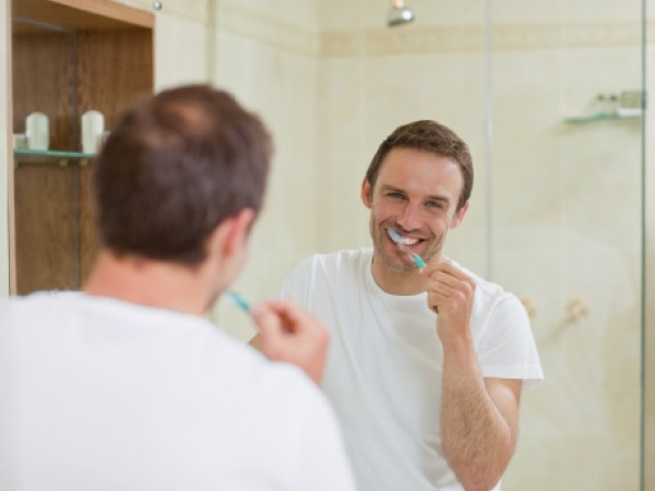 Get Whiter Teeth With Homemade Coconut Oil Toothpaste