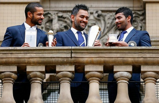 India's Dhawan, Dhoni and Jadeja pose with the ICC Champions Trophy