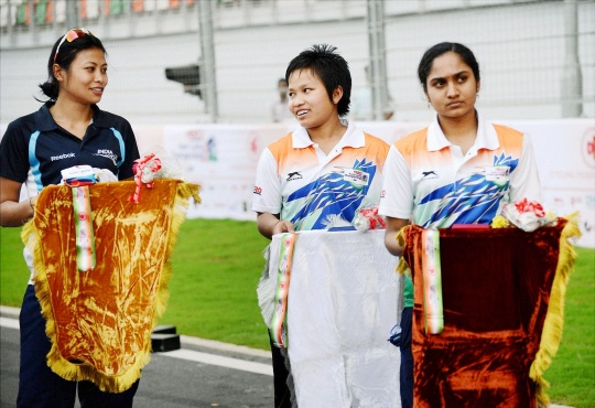 Indian Cyclists Made to Carry Medal Trays