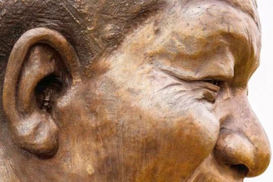 Rabbit in mandela statue ear
