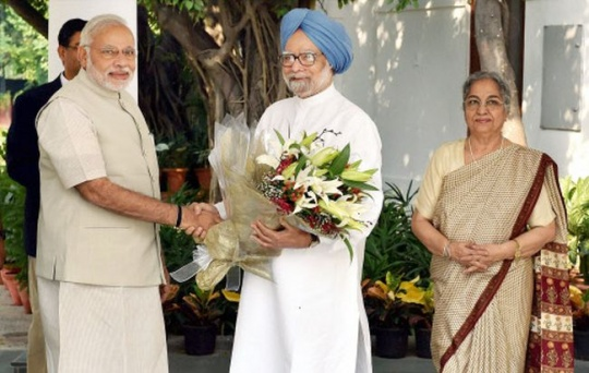 Prime Minister Narendra Modi greets former Prime Minister Manmohan Sing