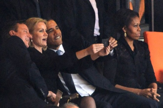 President Barack Obama and British Prime Minister David Cameron pose for a picture with Denmark's Prime Minister Helle Thorning Schmidt
