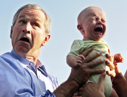 George W Bush with a crying baby