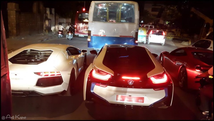 This Photograph Of Supercars Stuck In Traffic Behind A Bus Went