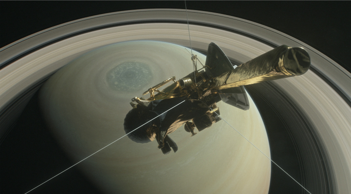An illustration of NASA's Cassini spacecraft above Saturn