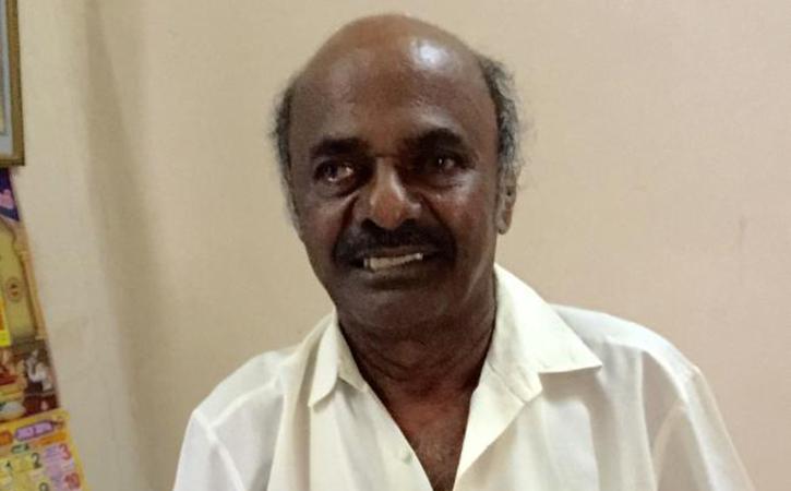 Muralitharan father
