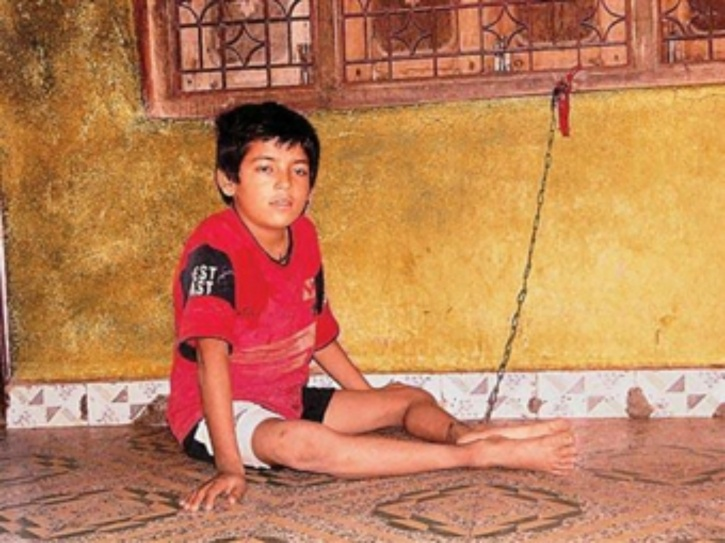 Boy chained to his fate