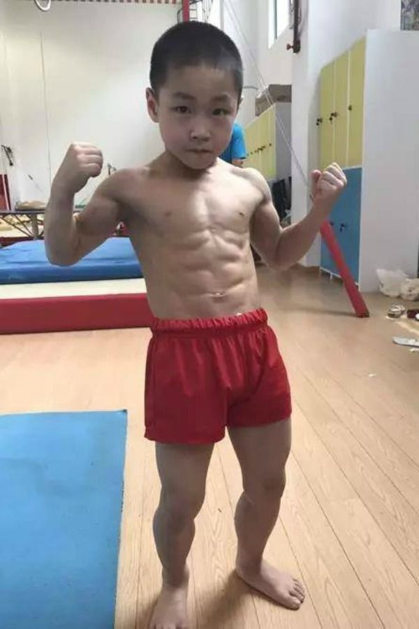 No mood to workout this 7 year old chinese boy with 8 pack abs is but if some inspiration is what you are looking for meet chen yi a seven year old chinese boy with an eight pack whos become an overnight sensation on ccuart Image collections