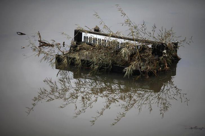 A piano is submerged in water in the area devastated