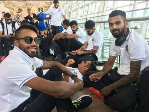 Image result for dhoni sleeps at airport chennai