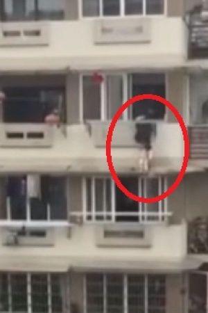 Man Saves Child Stuck On Ledge