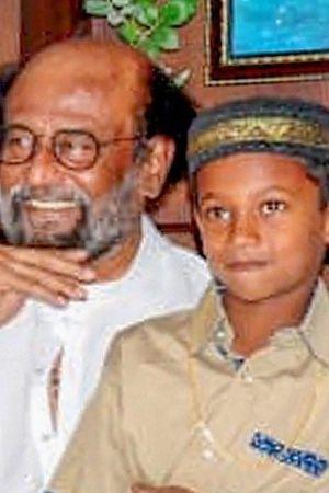 Rajinikanth Praises 7YearOld Boys Honesty For Returning Rs 50000 Will Sponsor His Education