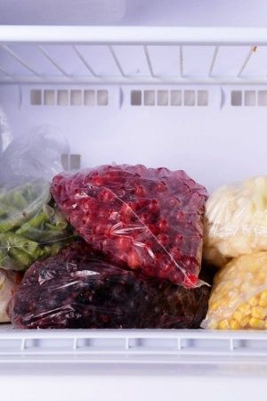 7 Frozen Foods Everyone Should Always Have Stacked In Their Refrigerator