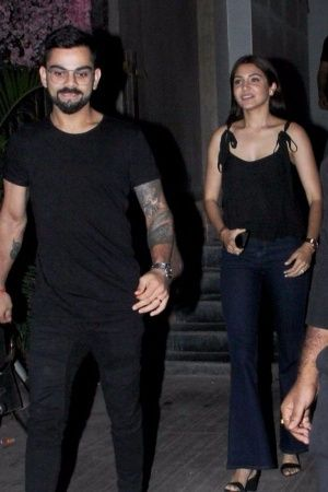A picture of Virat Kohli and Anushka Sharma colourcoordinating for a romantic dinner date