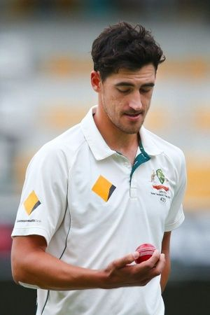 Mitchell Starc and Virat Kohli