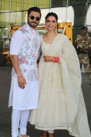Ranveer Singh and Deepika Padukone pose at Mumbai airport as they head to Bengaluru for wedding rece