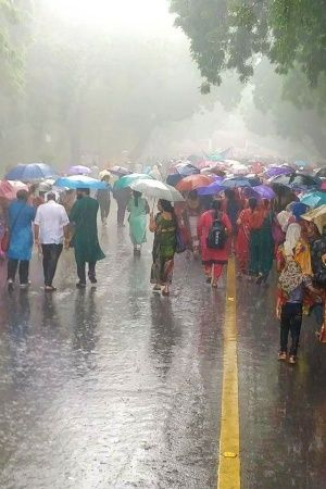 Braving Heavy Downpour In Delhi Thousands Of Women March To Parliament Against Modi Government