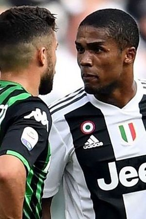 douglas costa slapped with four match ban