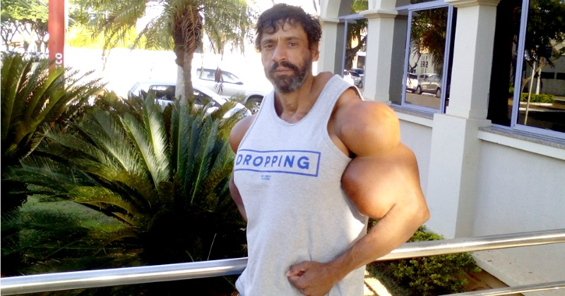 This Body-Builder Has Been Injecting Oil To Get 23-Inch ...  This Body-Build...