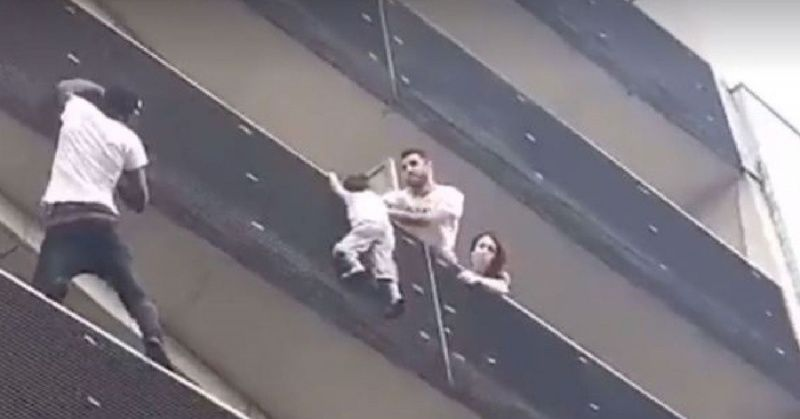 See this real time Spiderman scaling a building to rescue a kid