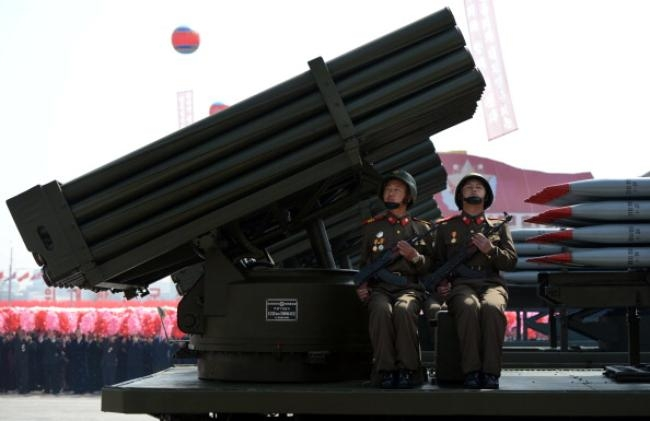 North Korean soldiers ride on the back o
