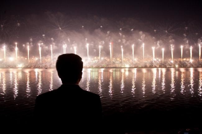A man watches a fireworks display to mar