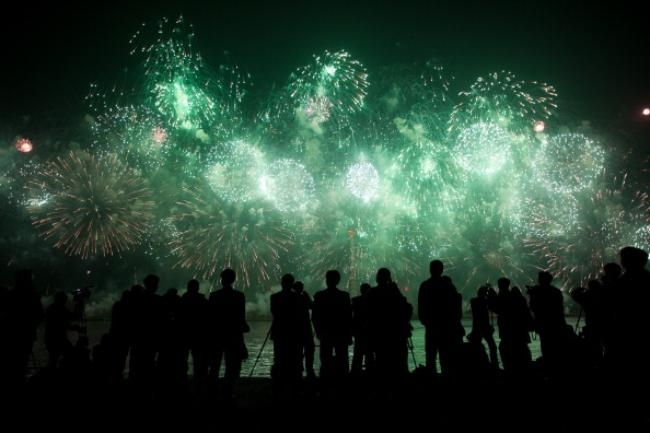 People watch a fireworks display to mark