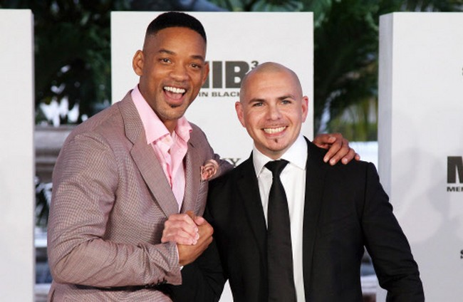 Will Smith, left, and singer Pittbull pose for photos to promote their upcoming film