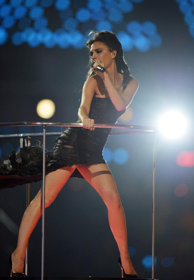 Victoria Beckham of Spice Girls performs